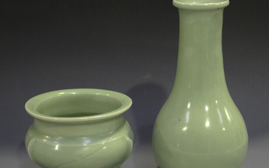 A Chinese celadon glazed vase of low-bellied form with tapered neck, height 19.4cm, together with a
