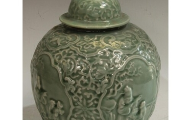 A Chinese celadon ovoid wine jar and cover, moulded in relie...