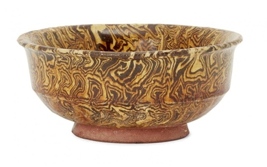 A Chinese marbled-pottery bowl, Tang dynasty, with steep straight sides...
