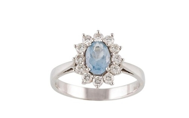 A DIAMOND AND AQUAMARINE CLUSTER RING, mounted in 18ct white...