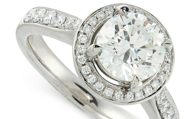 A DIAMOND CLUSTER RING in platinum, set with a round