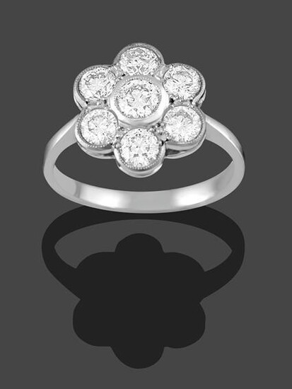 A Diamond Cluster Ring, the round brilliant cut diamond within...