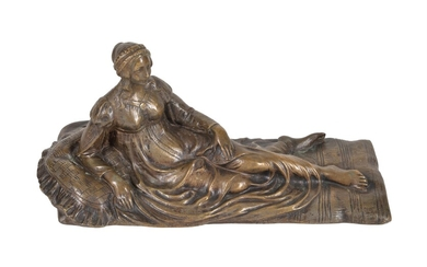 A French gilt bronze model of a reclining maiden
