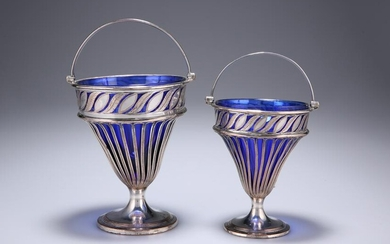 A GRADUATED PAIR OF OLD SHEFFIELD PLATED SWING-HANDLED