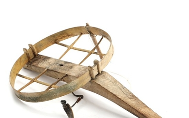 A Greenlandic 20th century carved bone and wood kayak chair. H. 17. L. 50. W. 32 cm.