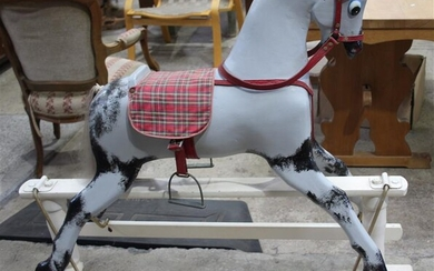 A PAINTED WOODEN ROCKING HORSE