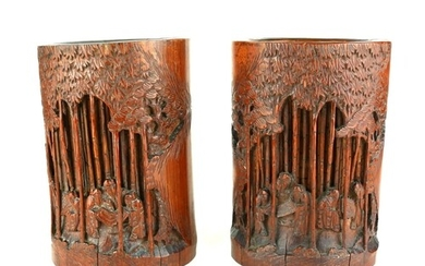 A PAIR OF CHINESE BAMBOO BRUSH POTS Hand carved figures in a...