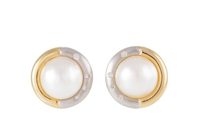 A PAIR OF DIAMOND AND MABE PEARL EARRINGS, the pearls to two...