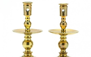 A Pair of Early Brass Candlesticks