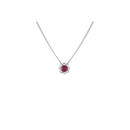 A RUBY AND DIAMOND CLUSTER PENDANT, of circular form, mounte...