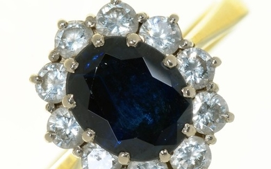 A SAPPHIRE AND DIAMOND CLUSTER RING IN 18CT GOLD, LONDON 198...