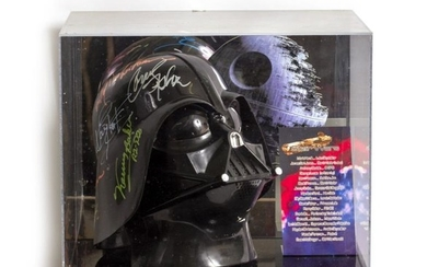 A SIGNED STAR WARS DARTH VADER REPLICA HELMET by...