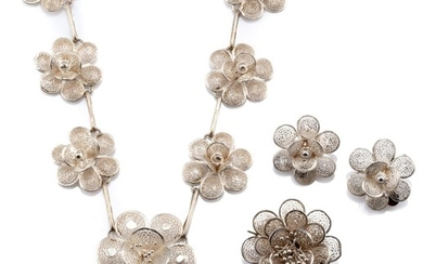 A SILVER JEWELLERY SUITE; necklace, brooch and clip earrings all featuring cannetille style floral clusters, necklace length 45cm.