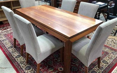 A SOLID TIMBER DINING TABLE WITH SIX CHAIRS
