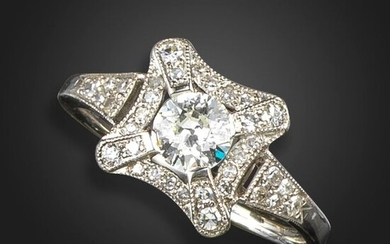 A diamond cluster ring, centred within an old circular-cut diamond weighing approximately 0.50cts, within a square-shaped surround set with old circular-cut diamonds in platinum, size P
