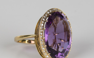 A gold, amethyst and rose cut diamond oval cluster ring, claw set with the oval cut amethyst within