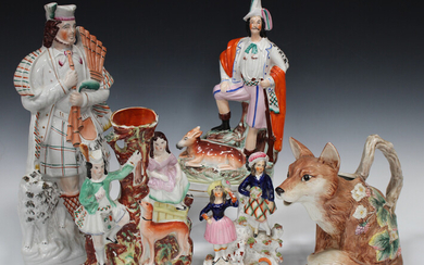 A group of decorative ceramics, late 19th and 20th century, including a large Staffordshire figure o
