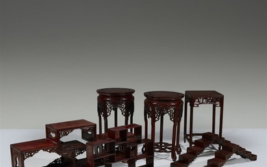 A group of seven assorted Chinese hardwood stands (7)....