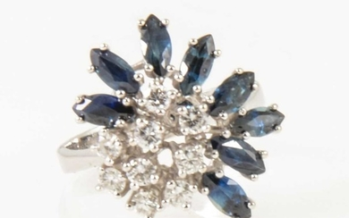A modern sapphire and diamond cluster ring.