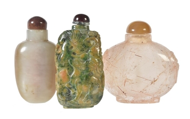 A mottled jade snuff bottle and stopper