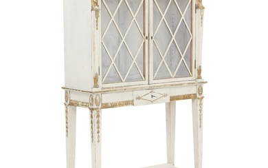 A painted and partially gilt Empire style display cabinet. 20th century. H. 138. W. 85 cm. D. 32 cm.