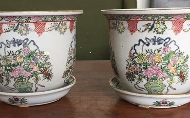 NOT SOLD. A pair of Chinese porcelain flower pots with dish decorated in colours with...