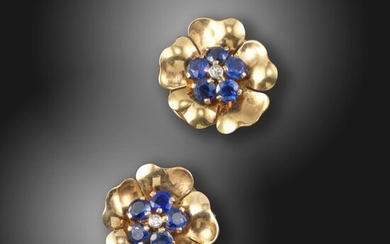 A pair of gem-set gold flower earrings by Boucheron, set with circular-cut sapphires and an old circular-cut diamond in gold, each signed Boucheron London, clip fittings, 1.7cm high, Boucheron case