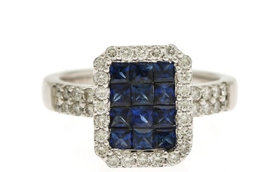 A ring set with numerous sapphires, totalling app. 1.20 ct. encircled by numerous diamonds, totalling app. 0.60 ct., mounted in 18k white gold. Size 54.