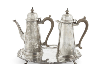 A set of English sterling silver coffee and milk pots