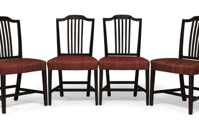 A set of four George III mahogany dining chairs, the...