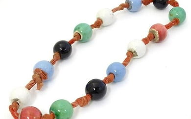 A vintage necklace of ceramic beads. Approx 24'' long