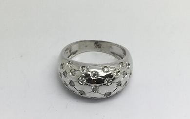 An 18ct white gold stone set band ring, approx 10g and appro...