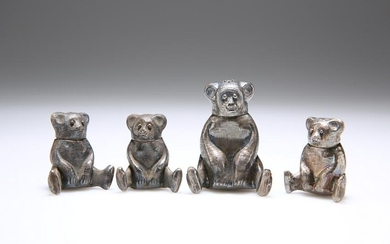 FOUR CHINESE WHITE METAL NOVELTY PEPPER POTS, each in