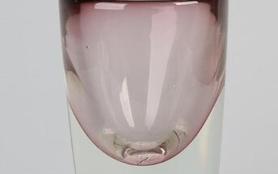 Heavy modern mouth-blown glass vase with object.