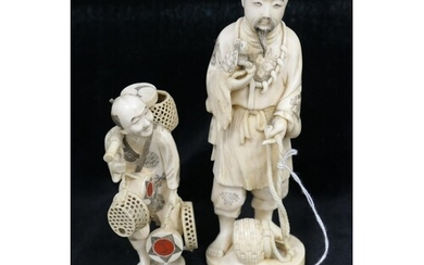Japanese carved ivory okimono worked as a man with a pet ter...