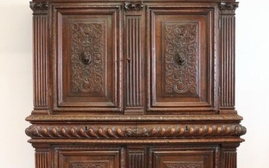 Moulded and carved wood sideboard with two doors, two drawers and two doors in the lower part.