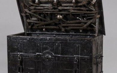 "NUREMBERG CASE, also known as ""CORSORIAL CASE"" made of Nuremberg riveted iron plates, two hasps and a false lock entrance in the front, the flap reveals its complex internal bolt lock system. The interior hides a small safe. Wrought iron carrying..."