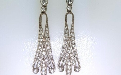 Pair of 750°/°°° white gold leafed earrings set with diamonds holding a cultured pearl in pendants, L.5,5cm, Gross weight: 8,35g