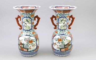 Pair of Japanese Export Vases with Imari-style Decor, Japan, Mid-19th C. Slightly bulbous shape with 2 large reserves of flowering peonies and birds. Long, cylindrical neck with two landscape figurines in matching cartouches. Curved rim. Iron red...