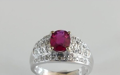 RING in 750°/°° white gold decorated with an oval ruby...