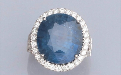 """Ring in 750°/00 (18K) white gold, set with a large 20.31 carat natural oval """"Color change"""" sapphire surrounded by brilliant-cut diamonds; the openworked setting is also set with diamonds. Laboratory certificate """"no heat treatment found"""". 14.5 g. TDD..."""