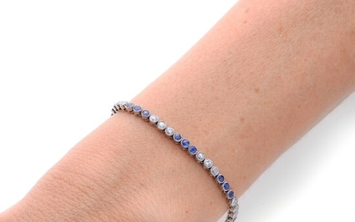 Tennis bracelet in white gold, diamonds and sapphires