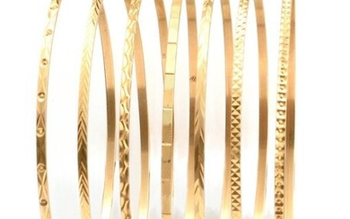 WEEKLY BRACELETS composed of seven yellow gold bracelets,...