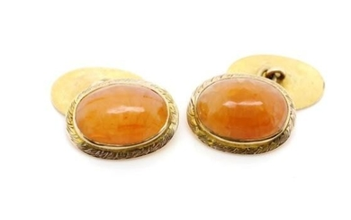 Yellow gold and carnelian cufflinks with oxford oval shields...