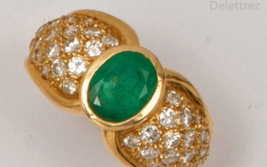 Yellow gold ring set with an oval emerald...