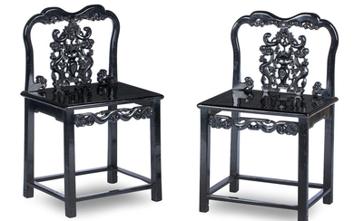 A pair of ebonised hardwood side chairs