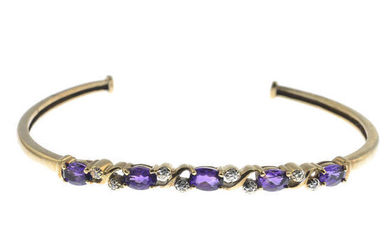 A 9ct gold amethyst and diamond cuff bangle.
