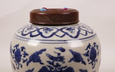 A Chinese blue and white ginger jar and wood cover, with pho...