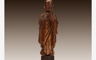 A Chinese gilt wood figural carving of a standing...