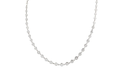 A DIAMOND LINE NECKLACE in 18ct white gold, with diamonds of...